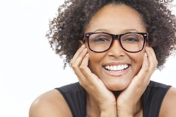 Woman with porcelain veneers smiling at Webster Groves dentist office