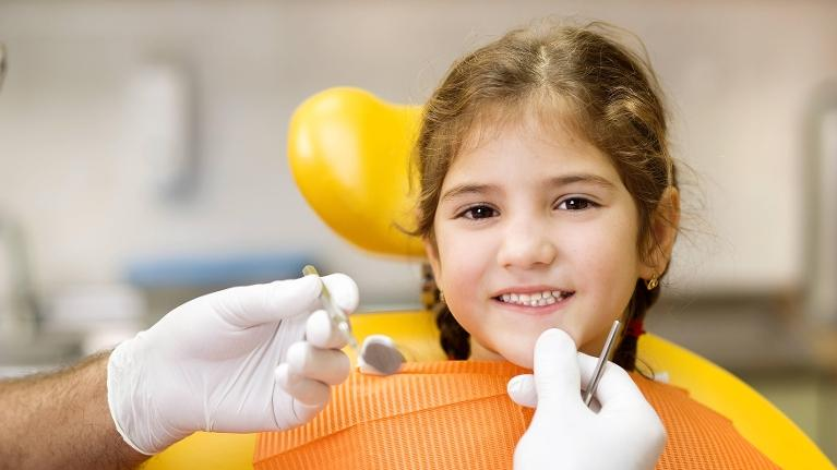 Young girl visiting children's dentist in Webster Groves MO